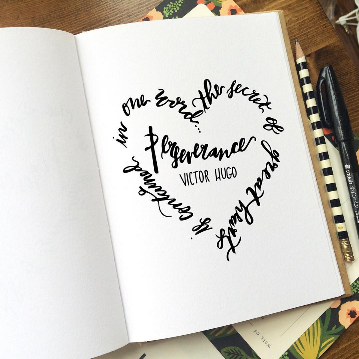 Lettering example of quote by Victor Hugo in the shape of a heart